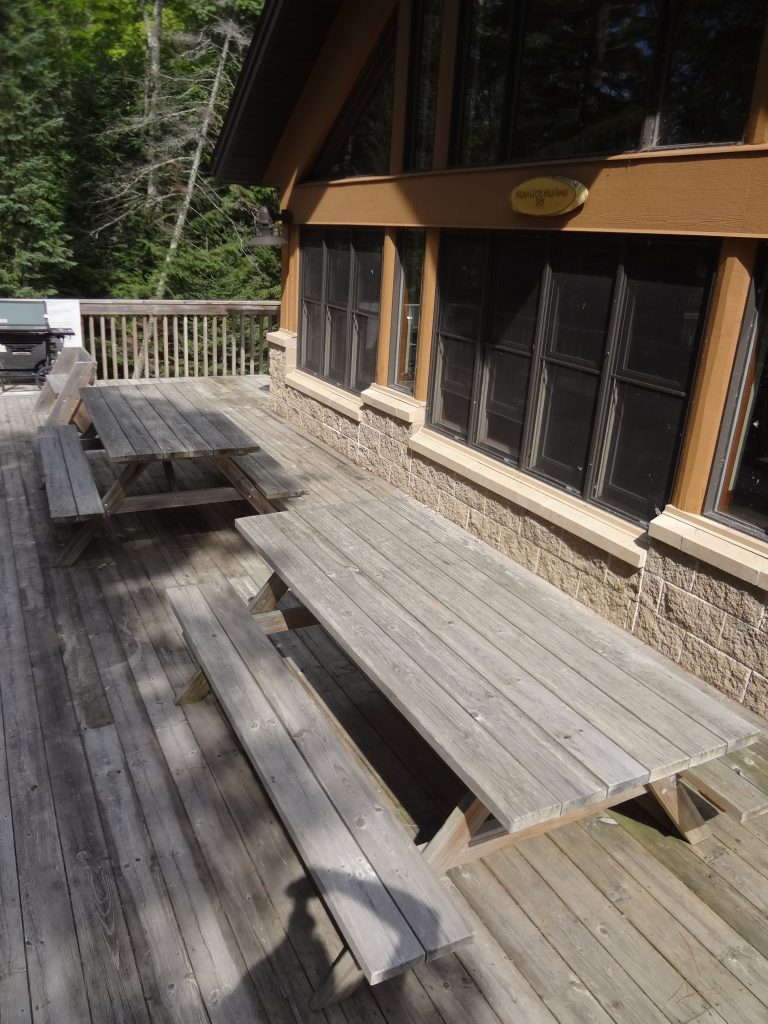 picnic tables on wooden deck