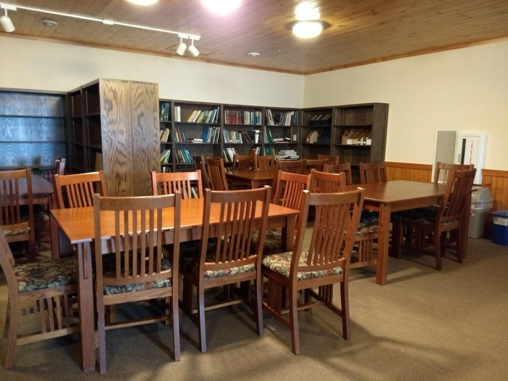 table with chairs, bookcases with books